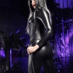 goddess-lamia-murder-mile-image black catsuit standing looking back